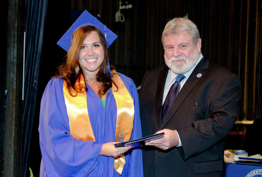 Leanniel Nyren, of Plantsville, is awarded the Rafael Squitieri, M.D. Award for Excellence by Dr. Francis Scifo during the twenty-first annual commencement ceremony of St. Vincent's College at the Arnold Bernhard Center at the University of Bridgeport campus on Friday, May 17, 2013. Photo: Amy Mortensen / Connecticut Post Freelance