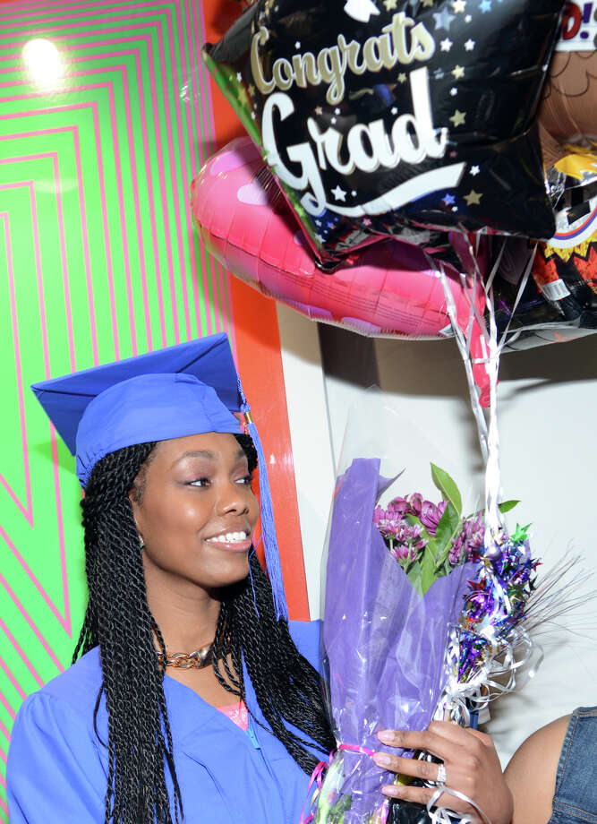 Porcha Porchea, of Stratford, holds a bundle of balloons following the twenty-first annual commencement ceremony of St. Vincent's College at the Arnold Bernhard Center at the University of Bridgeport campus on Friday, May 17, 2013. Photo: Amy Mortensen / Connecticut Post Freelance