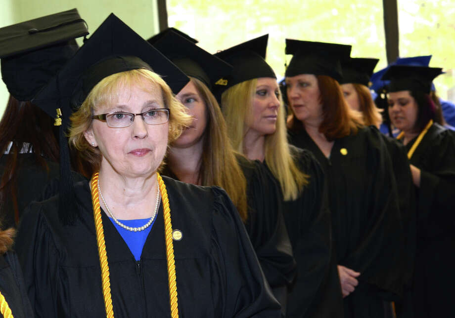 Graduating with a Bachelor of Science in Nursing degree, Mary Ellen Lang, of Shelton, stands with her classmates in the staging area prior to the start of the twenty-first annual commencement ceremony of St. Vincent's College at the Arnold Bernhard Center at the University of Bridgeport campus on Friday, May 17, 2013. Photo: Amy Mortensen / Connecticut Post Freelance
