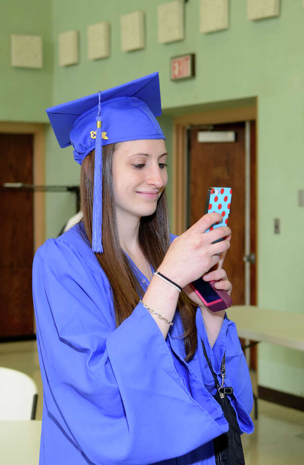 Brittany Timko, of Branford, snaps a photo in the staging area during the twenty-first annual commencement ceremony of St. Vincent's College at the Arnold Bernhard Center at the University of Bridgeport campus on Friday, May 17, 2013. Photo: Amy Mortensen / Connecticut Post Freelance