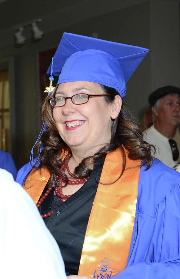 Patricia Craig, of Stamford, smiles during the twenty-first annual commencement ceremony of St. Vincent's College at the Arnold Bernhard Center at the University of Bridgeport campus on Friday, May 17, 2013. Photo: Amy Mortensen / Connecticut Post Freelance