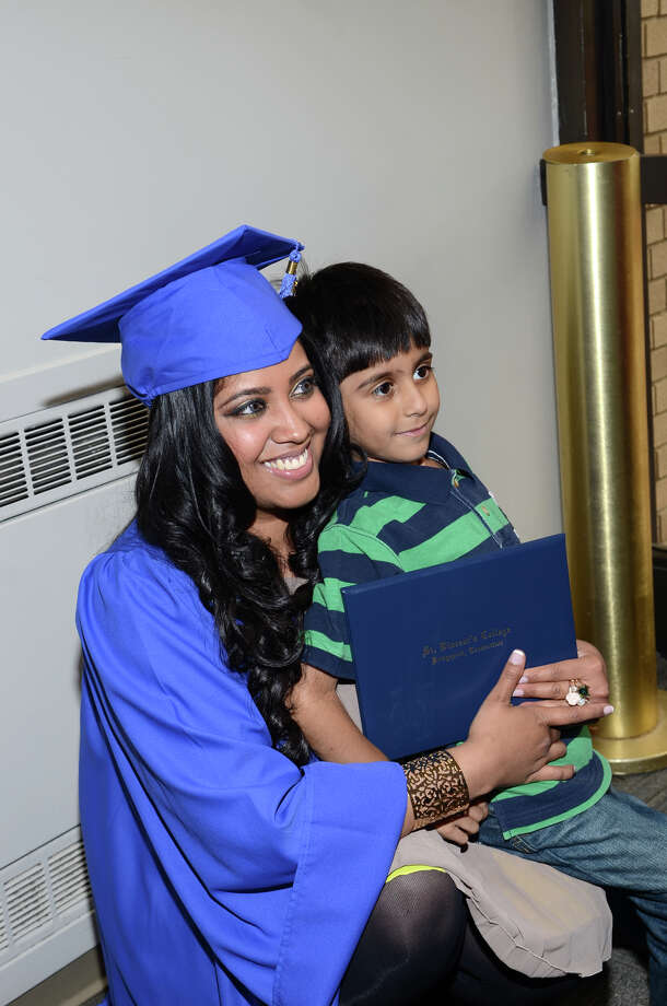 Sobia Khan, of Bridgeport, hugs Ahmer Faisal, 5, also of Bridgeport, following the twenty-first annual commencement ceremony of St. Vincent's College at the Arnold Bernhard Center at the University of Bridgeport campus on Friday, May 17, 2013. Photo: Amy Mortensen / Connecticut Post Freelance