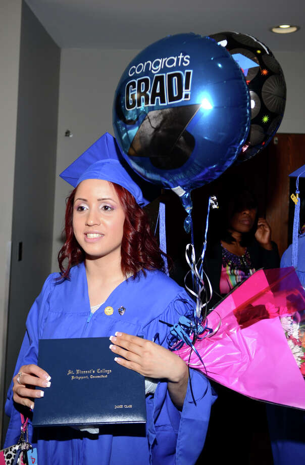 Jamie Class, of East Haven, holds a bundle of balloons following the twenty-first annual commencement ceremony of St. Vincent's College at the Arnold Bernhard Center at the University of Bridgeport campus on Friday, May 17, 2013. Photo: Amy Mortensen / Connecticut Post Freelance