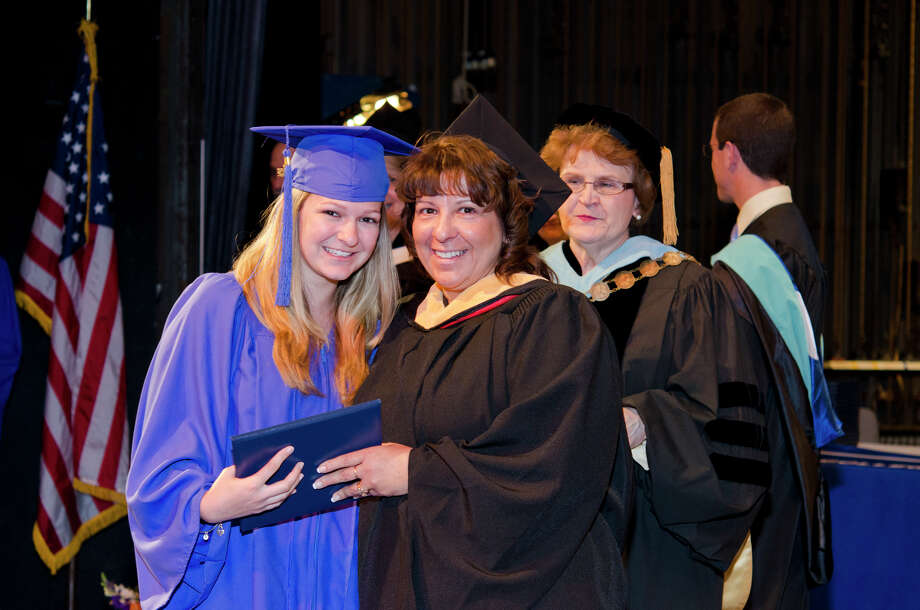 Samantha Smith, of Stratford, is awarded her diploma by her mother Robin Smith, Assistant Professor of Radiology, during the twenty-first annual commencement ceremony of St. Vincent's College at the Arnold Bernhard Center at the University of Bridgeport campus on Friday, May 17, 2013. Photo: Amy Mortensen / Connecticut Post Freelance
