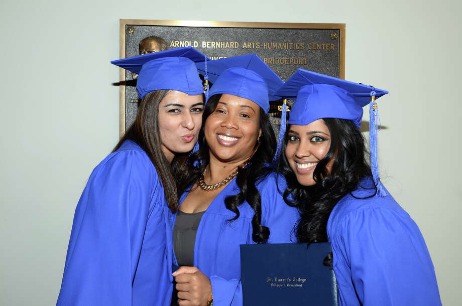 Graduates pose for a photo following the twenty-first annual commencement ceremony of St. Vincent's College at the Arnold Bernhard Center at the University of Bridgeport campus on Friday, May 17, 2013. Photo: Amy Mortensen / Connecticut Post Freelance