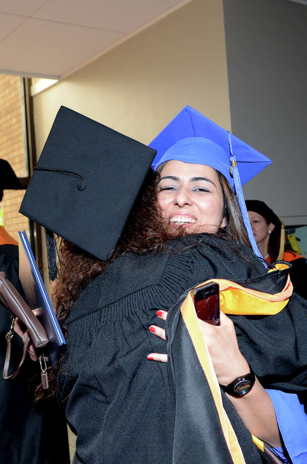 Madiha Khan, of Seymour, celebrates following the twenty-first annual commencement ceremony of St. Vincent's College at the Arnold Bernhard Center at the University of Bridgeport campus on Friday, May 17, 2013. Photo: Amy Mortensen / Connecticut Post Freelance