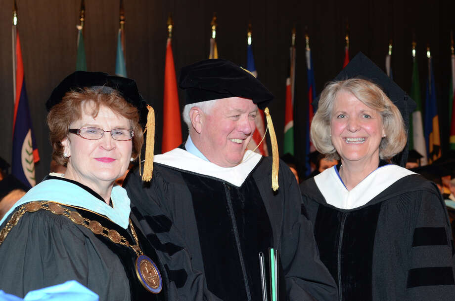 Honorary Degree Recipient, Chuck Mattes, center, stands with Martha Shouldis, President and CEO of St. Vincent's College, and Marianne Laska, Chairperson, Board of Trustees, at right, during the twenty-first annual commencement ceremony of St. Vincent's College at the Arnold Bernhard Center at the University of Bridgeport campus on Friday, May 17, 2013. Photo: Amy Mortensen / Connecticut Post Freelance