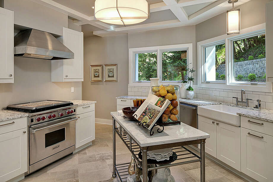 Kitchen of 2222 Everett Ave. E., in Capitol Hill. The 6,897-square-foot Mediterranean-style home, built in 1926, has four bedrooms, three bathrooms, two fireplaces, ornate, hand-restored ironwork and millwork, a ballroom, an office, a family room, a game room, a media room, a sun room, a play room, a two-car garage, a 1,794-square-foot unfinished sub-basement, a fountain, decks and patios on a 30,986-square-foot property. It's listed for $3.495 million. Photo: Matt Edington, Courtesy Nicholas Glant, NWG Real Estate / Clarity Northwest Photography