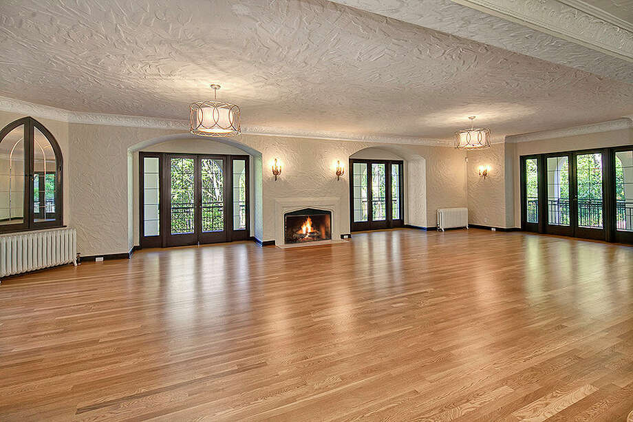 Ballroom of 2222 Everett Ave. E., in Capitol Hill. The 6,897-square-foot Mediterranean-style home, built in 1926, has four bedrooms, three bathrooms, two fireplaces, ornate, hand-restored ironwork and millwork, an office, a family room, a game room, a media room, a sun room, a play room, a two-car garage, a 1,794-square-foot unfinished sub-basement, a fountain, decks and patios on a 30,986-square-foot property. It's listed for $3.495 million. Photo: Matt Edington, Courtesy Nicholas Glant, NWG Real Estate / Clarity Northwest Photography