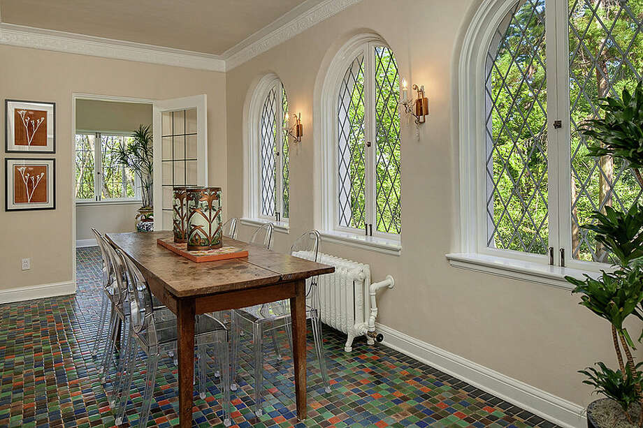 Sun room of 2222 Everett Ave. E., in Capitol Hill. The 6,897-square-foot Mediterranean-style home, built in 1926, has four bedrooms, three bathrooms, two fireplaces, ornate, hand-restored ironwork and millwork, a ballroom, an office, a family room, a game room, a media room, a play room, a two-car garage, a 1,794-square-foot unfinished sub-basement, a fountain, decks and patios on a 30,986-square-foot property. It's listed for $3.495 million. Photo: Matt Edington, Courtesy Nicholas Glant, NWG Real Estate / Clarity Northwest Photography