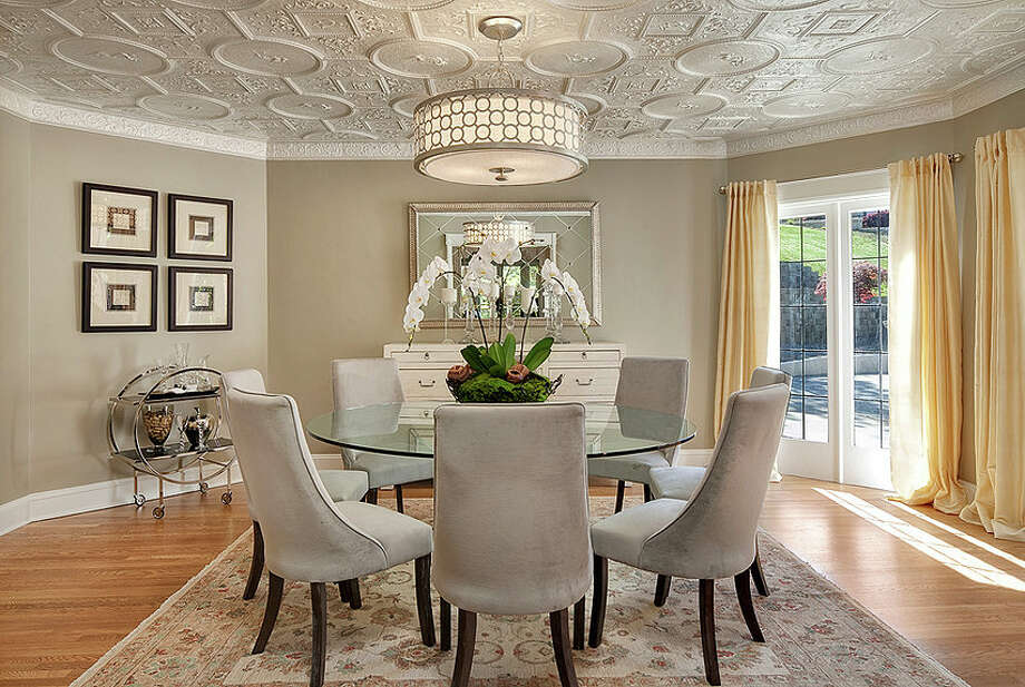 Dining room of 2222 Everett Ave. E., in Capitol Hill. The 6,897-square-foot Mediterranean-style home, built in 1926, has four bedrooms, three bathrooms, two fireplaces, ornate, hand-restored ironwork and millwork, a ballroom, an office, a family room, a game room, a media room, a sun room, a play room, a two-car garage, a 1,794-square-foot unfinished sub-basement, a fountain, decks and patios on a 30,986-square-foot property. It's listed for $3.495 million. Photo: Matt Edington, Courtesy Nicholas Glant, NWG Real Estate / Clarity Northwest Photography