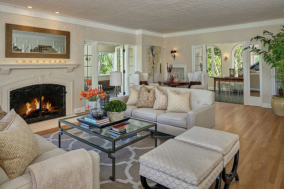 Living room of 2222 Everett Ave. E., in Capitol Hill. The 6,897-square-foot Mediterranean-style home, built in 1926, has four bedrooms, three bathrooms, two fireplaces, ornate, hand-restored ironwork and millwork, a ballroom, an office, a family room, a game room, a media room, a sun room, a play room, a two-car garage, a 1,794-square-foot unfinished sub-basement, a fountain, decks and patios on a 30,986-square-foot property. It's listed for $3.495 million. Photo: Matt Edington, Courtesy Nicholas Glant, NWG Real Estate / Clarity Northwest Photography
