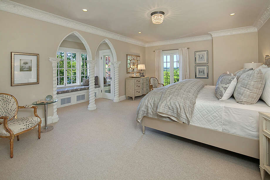 Bedroom of 2222 Everett Ave. E., in Capitol Hill. The 6,897-square-foot Mediterranean-style home, built in 1926, has four bedrooms, three bathrooms, two fireplaces, ornate, hand-restored ironwork and millwork, a ballroom, an office, a family room, a game room, a media room, a sun room, a play room, a two-car garage, a 1,794-square-foot unfinished sub-basement, a fountain, decks and patios on a 30,986-square-foot property. It's listed for $3.495 million. Photo: Matt Edington, Courtesy Nicholas Glant, NWG Real Estate / Clarity Northwest Photography