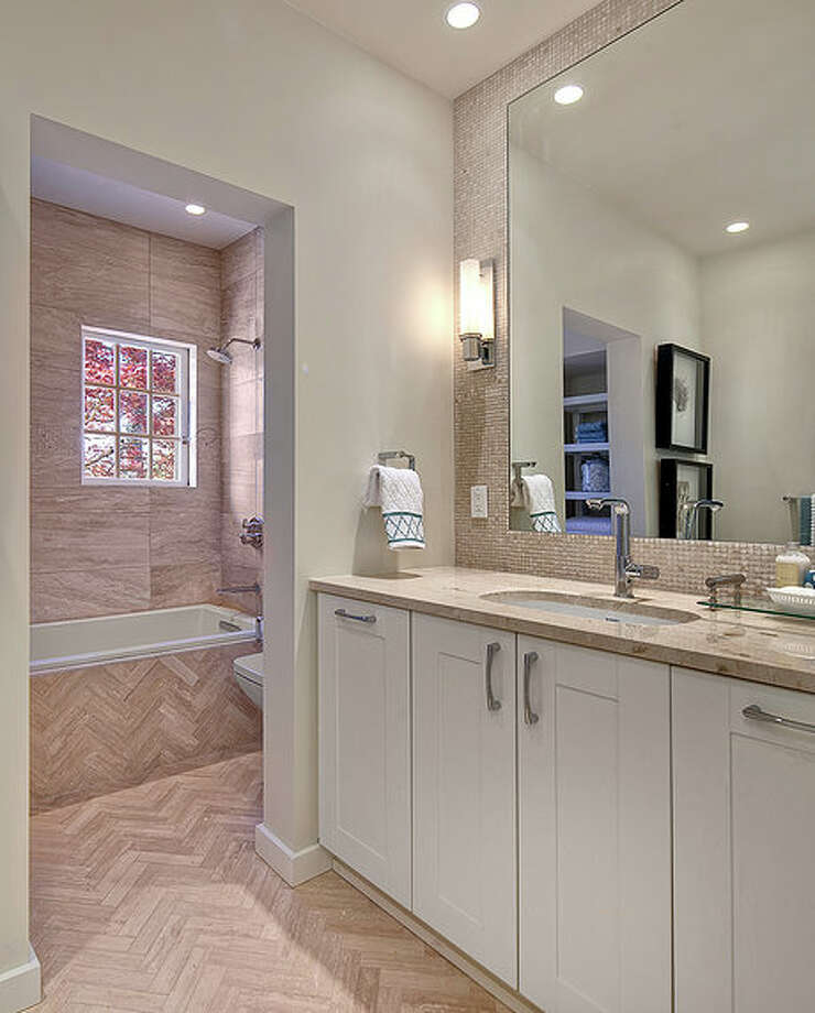 Bathroom of 2222 Everett Ave. E., in Capitol Hill. The 6,897-square-foot Mediterranean-style home, built in 1926, has four bedrooms, three bathrooms, two fireplaces, ornate, hand-restored ironwork and millwork, a ballroom, an office, a family room, a game room, a media room, a sun room, a play room, a two-car garage, a 1,794-square-foot unfinished sub-basement, a fountain, decks and patios on a 30,986-square-foot property. It's listed for $3.495 million. Photo: Matt Edington, Courtesy Nicholas Glant, NWG Real Estate / Clarity Northwest Photography