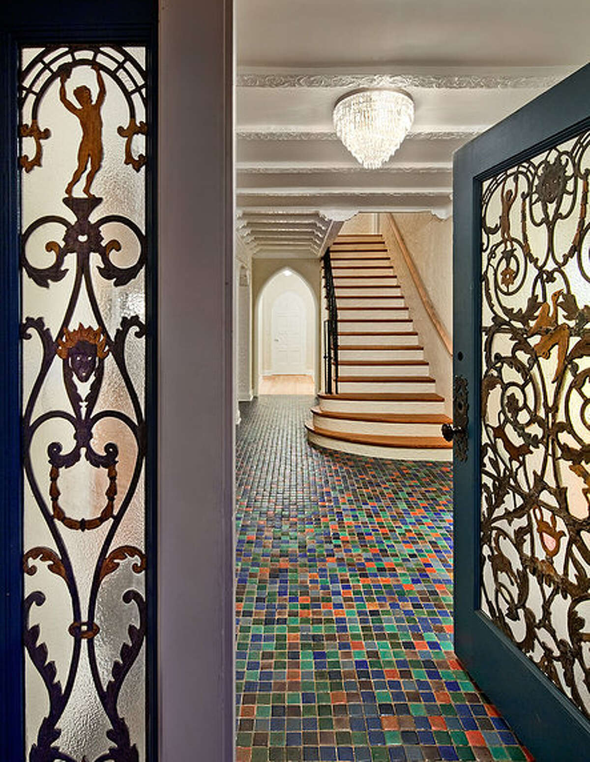 Entry of 2222 Everett Ave. E., in Capitol Hill. The 6,897-square-foot Mediterranean-style home, built in 1926, has four bedrooms, three bathrooms, two fireplaces, ornate, hand-restored ironwork and millwork, a ballroom, an office, a family room, a game room, a media room, a sun room, a play room, a two-car garage, a 1,794-square-foot unfinished sub-basement, a fountain, decks and patios on a 30,986-square-foot property. It's listed for $3.495 million.