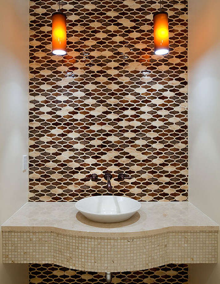Bathroom of 2222 Everett Ave. E., in Capitol Hill. The 6,897-square-foot Mediterranean-style home, built in 1926, has four bedrooms, three bathrooms, two fireplaces, ornate, hand-restored ironwork and millwork, a ballroom, an office, a family room, a game room, a media room, a sun room, a play room, a two-car garage, a 1,794-square-foot unfinished sub-basement, a fountain, decks and patios on a 30,986-square-foot property. It's listed for $3.495 million. Photo: Matt Edington, Courtesy Nicholas Glant, NWG Real Estate / (c) 2013 Chris J. Roberts Photography (206) 365-7727