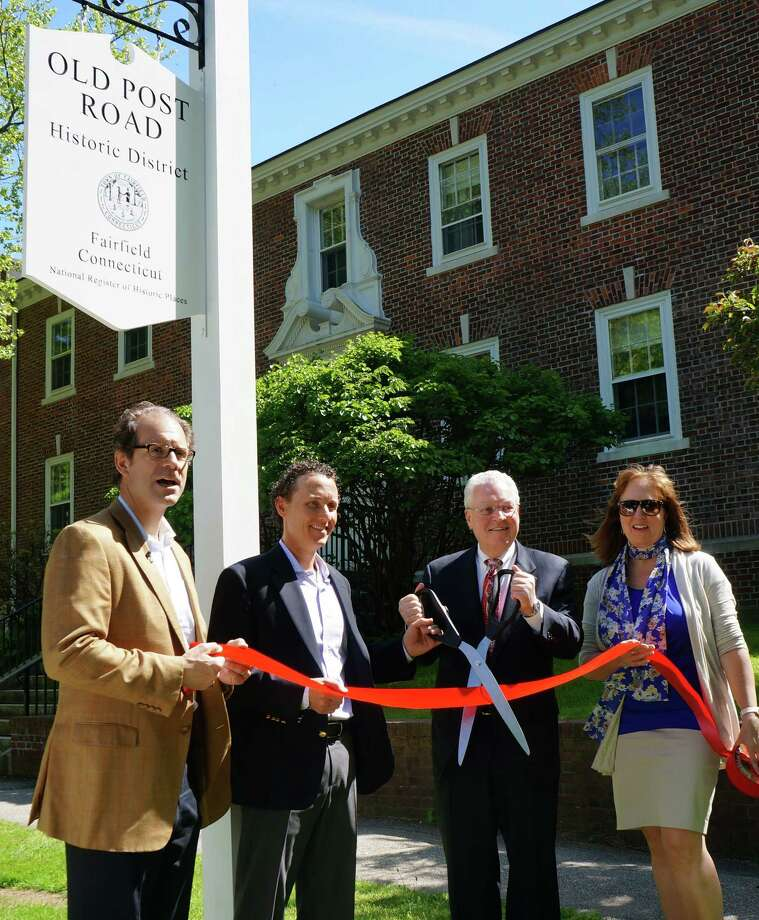Old Post Road Area Association President Peter Petron, Vice President Dan Miller, First Selectman Mike Tetreau, and Meri Eirckson, from the Fairfield Museum and History Center, cut a ceremonial ribbon at a new historic district sign on Beach Road. Photo: Genevieve Reilly / Fairfield Citizen