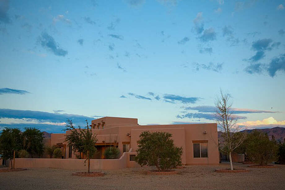 The exterior of the New Mexico main home. Photos: CNBC and Auction Company of America.