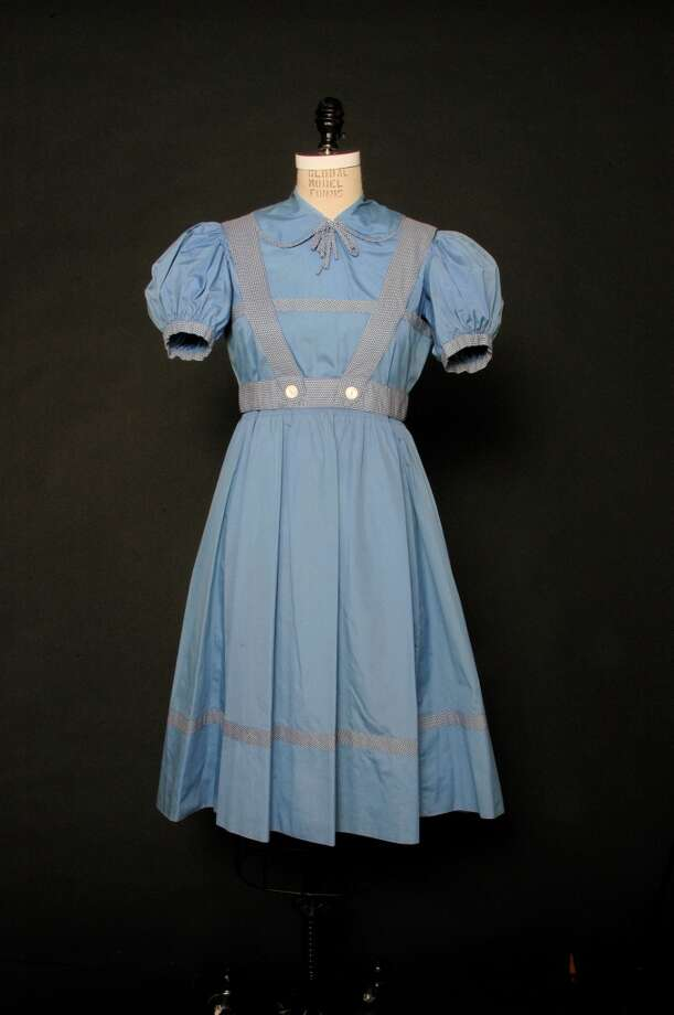 Dorothy Gale dress from the Richard Thorpe filming of the Wizard of Oz.   Photo by Russ Fischella Photo: Russ Fischella