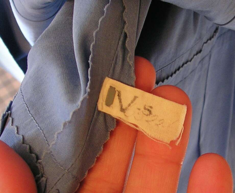 Original MGM dry cleaners tag sewn on the dress