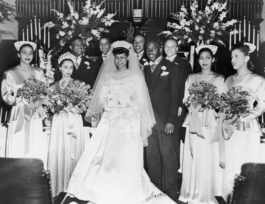 Another baseball legend, Jackie Robinson, at his wedding to Rachel Isum at the Independent Church in Los Angeles on February 1946. Check out the strange crowns worn by the bridesmaids. Photo: Archive Photos, Getty Images