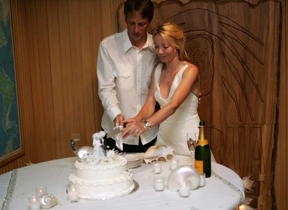 Newlyweds Tony Hawk and Lhotse Merriam cut a slice of cake at their wedding reception Jan. 12, 2006 in Fiji. Photo: Mark Epstein, Getty Images