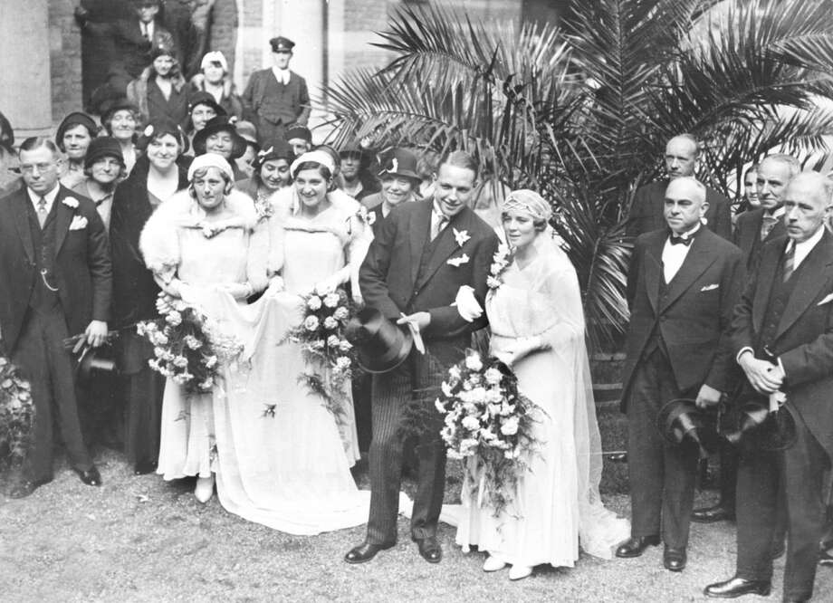 Miss Marie Braun, a Dutch Olympic swimming champion who set world records at the 1928 Olympic Games in Amsterdam, marries Mr. Phillipson in 1931. Photo: Planet News Archive, SSPL Via Getty Images