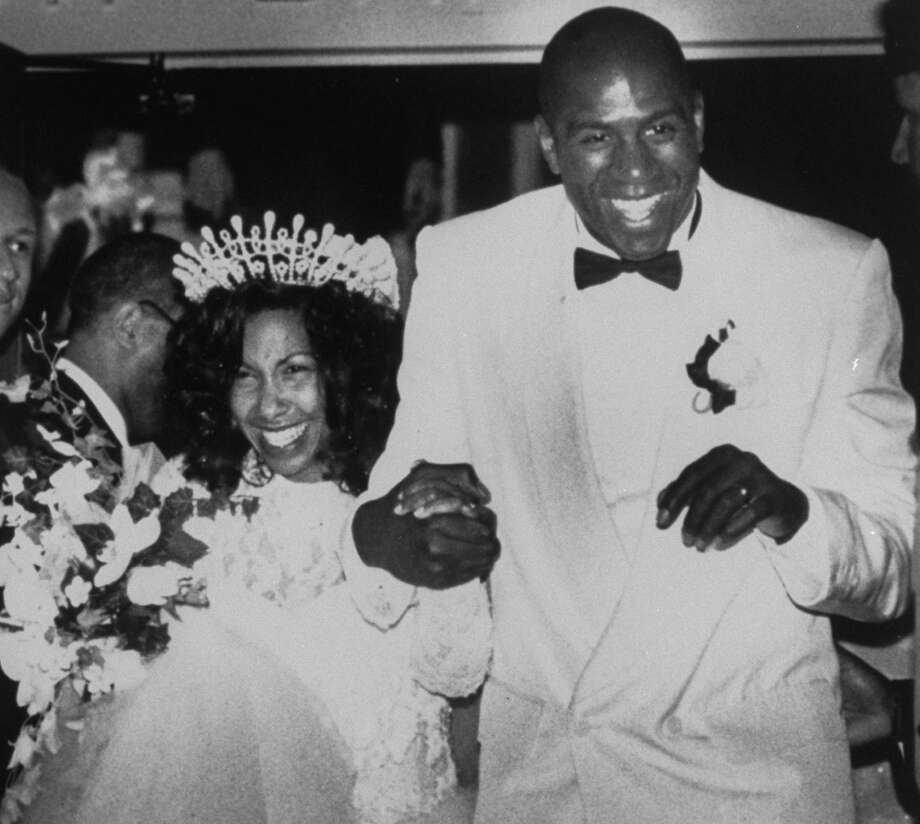 Magic Johnson with his wife Earletha Cookie Kelly on their wedding day at Union Missionary Baptist Church in 1991. Photo: Chris Holmes, Time & Life Pictures/Getty Image