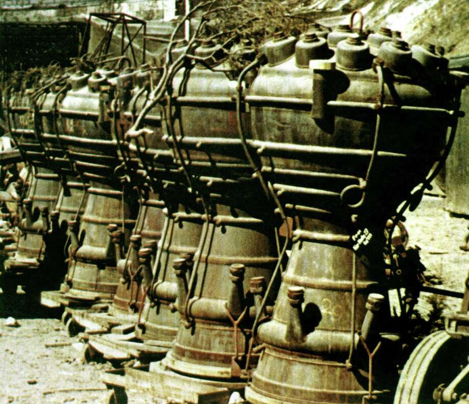 V-2 rocket engines are stored near the Dora Mittelbau concentration camp and underground rocket factory, in Nordhausen, Germany on April 15, 1945. More than 20,000 inmates died in the camp. Photo: Galerie Bilderwelt, Getty Images / 2013 Galerie Bilderwelt