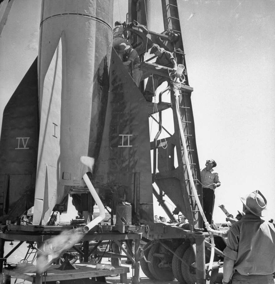 German scientists working with Americans fuel a V-2 rocket prior to a test launch in May 1946 at the White Sands Proving Ground, in Las Cruces, N.M. Photo: Tony Linck, Time & Life Pictures/Getty Image / Tony Linck