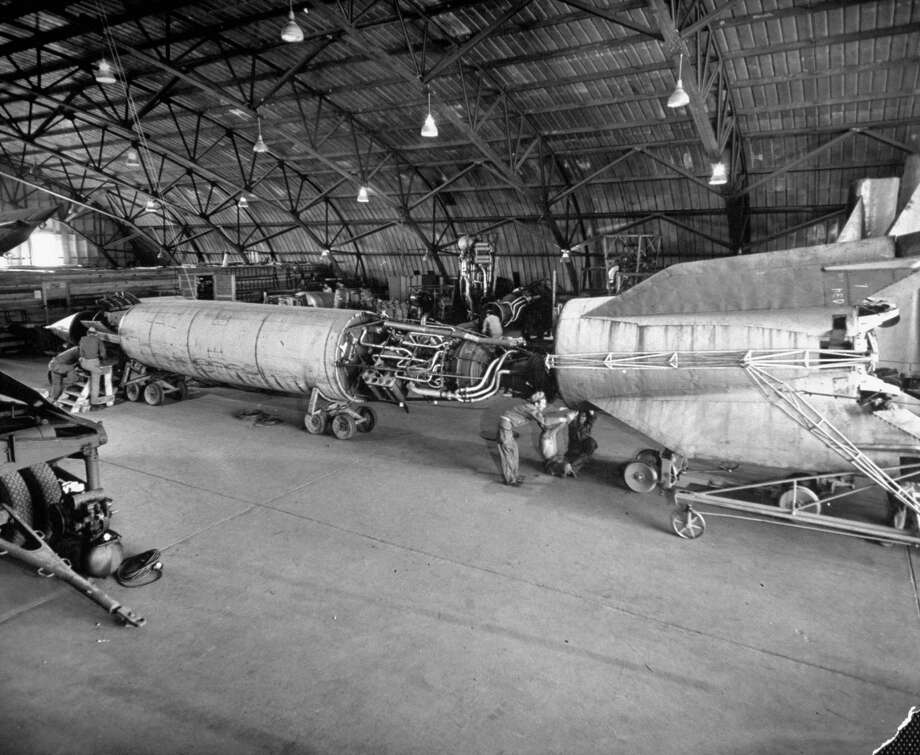 Germans and Americans work together assembling a V-2 rocket for a test launch in May 1946 at the White Sands Proving Ground, in Las Cruces, N.M. Photo: Tony Linck, Time & Life Pictures/Getty Image / Tony Linck