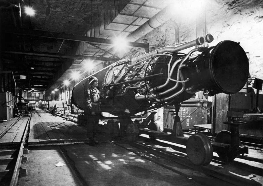 An American soldier examines a V-2 rocket under construction in an underground assembly plant in Nordhausen, Germany. The Flying Heritage Collection's V-2 was restored from interior components recovered in the 1990s from an underground production facility near Nordhausen. Photo: US Army, Time & Life Pictures/Getty Image / Time & Life Pictures
