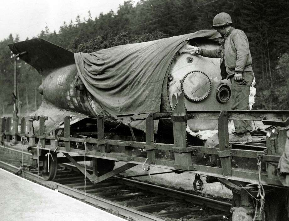 A U.S. soldier inspects the rear section of a German V-2 rocket that was being transported by train before the Americans advanced and captured the area. Photo: Popperfoto, Popperfoto/Getty Images / Popperfoto