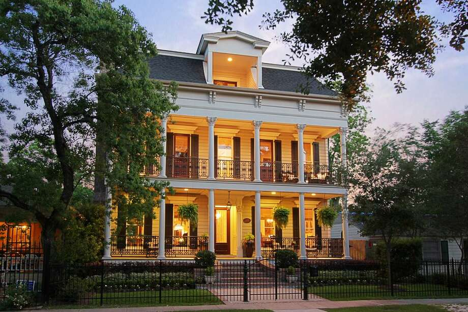 This New Orleans style home is an outstanding example of the fine work of Whitestone Builders. Double porches and ornate iron railings, plus an iron fence in front. Photo: HAR.com