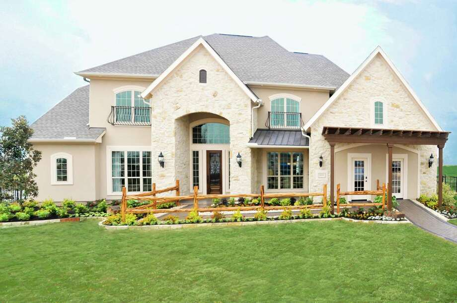 Toll Brothers has opened its first model home in the Vista Shores section of Towne Lake. Photo: Courtesy Photo / 2011 FrenchBlue Photography
