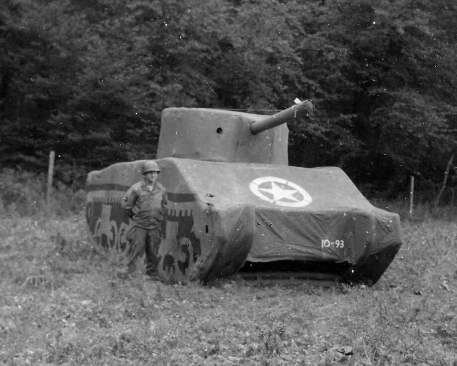PBS - The Ghost Army A Ghost Army soldier stands next to a rubber M4 Sherman tank, 93 pounds fully inflated. It took about 30 minutes to inflate a single tank, and the work was generally done at night so the Germans wouldn't see it. / For editorial use only in conjunction with the direct publicity or promotion of this program for a period of three years from th