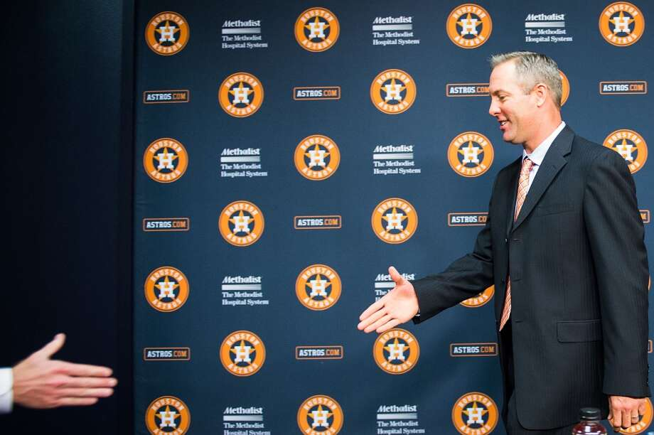Reid Ryan shakes hands after a press conference  where he was announced as the new Houston Astros president. Photo: Smiley N. Pool, Houston Chronicle
