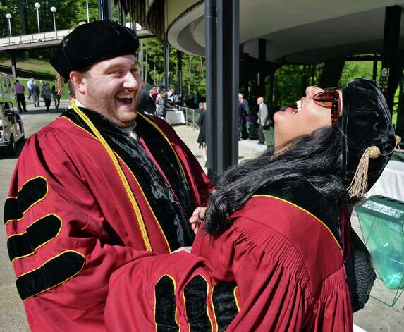 Albany Law School graduates Matthew Tulio, left, of Colonie and Chaula Shukla of Pelham during  commencement ceremonies at the Saratoga Performing Arts Center, Saratoga Springs, NY Friday May 17, 2013.  (John Carl D'Annibale / Times Union) Photo: John Carl D'Annibale / 10022118A