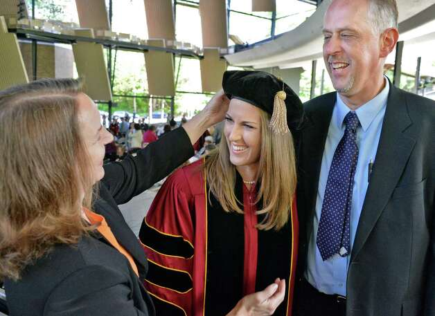 Albany Law School graduate Katherine Heeks with parnets Susan Heeks, left, and James Heeks of Rochester during  commencement ceremonies at the Saratoga Performing Arts Center, Saratoga Springs, NY Friday May 17, 2013.  (John Carl D'Annibale / Times Union) Photo: John Carl D'Annibale / 10022118A