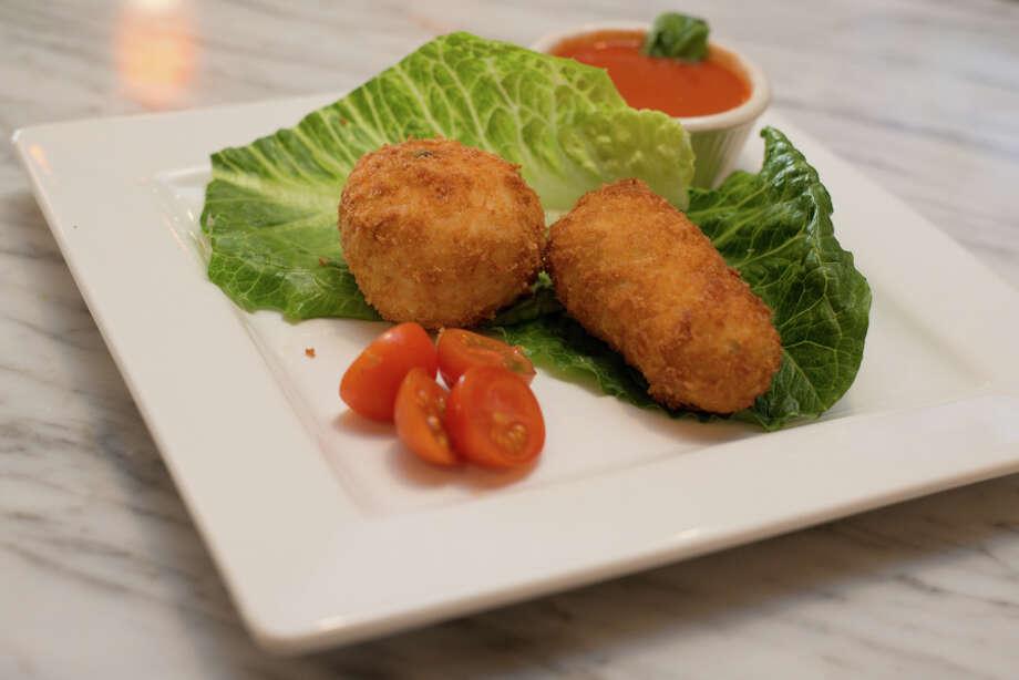 Arancini e Crocchette homemade rice balls and potato croquette - $8