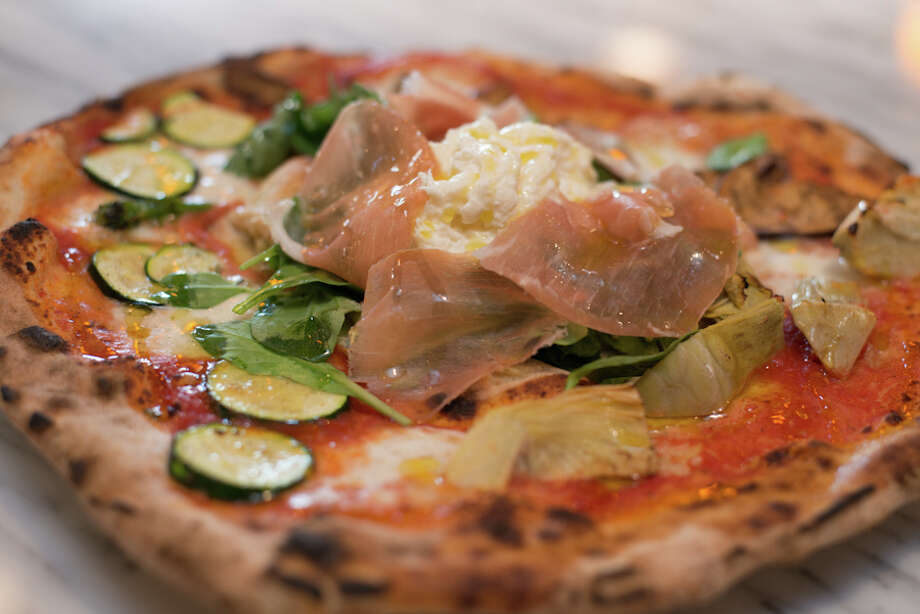 Quattro Stagioni, black olives, artichokes, mushrooms and ham - $17