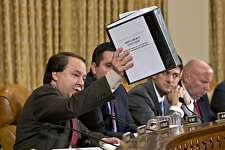 House Ways and Means Committee member  Rep. Pat Tiberi, R-Ohio, left, holds up a binder with documents about a constituent's application to the IRS that was delayed, on Capitol Hill in Washington, Friday, May 17, 2013, during the committee's hearing on the extra scrutiny the Internal Revenue Service gave Tea Party and other conservative groups that applied for tax-exempt status. From left are, Tiberi, R-Ohio, Rep. Devin Nunes, R-Calif., Rep. Paul Ryan, R-Wis., and Rep. Kevin Brady, R-Texas.  (AP Photo/J. Scott Applewhite)