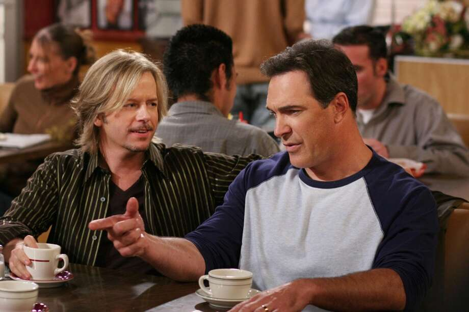 "Patrick Warburton (right), and  David Spade (left) in the CBS sitcom ""Rules of Engagement."""