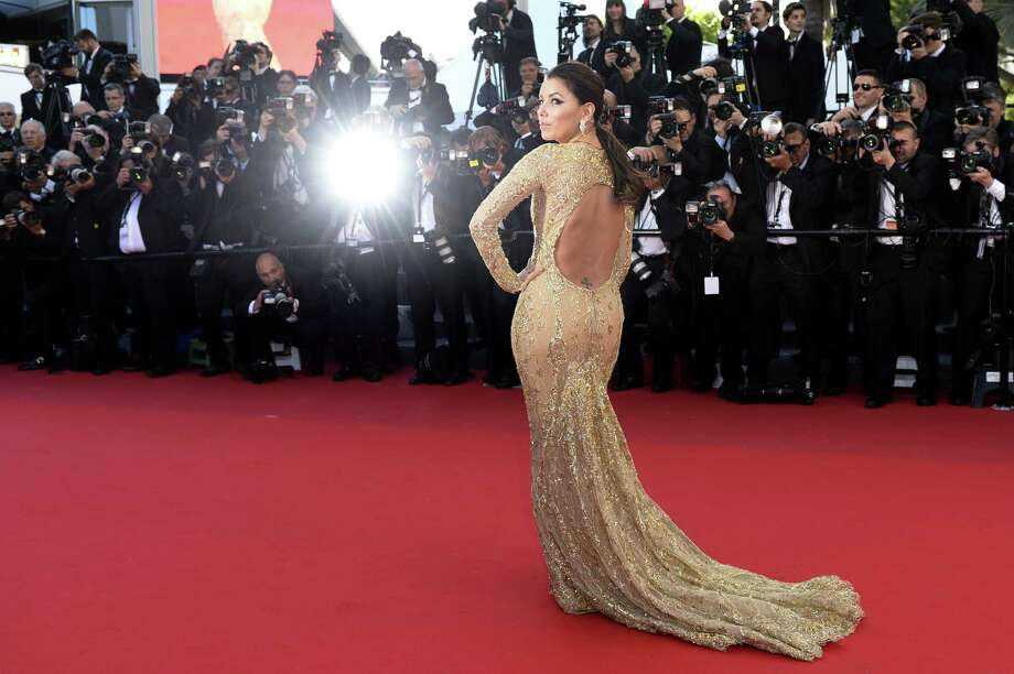 "Actress Eva Longoria poses on May 17, 2013 as she arrives for the screening of the film ""The Past"" presented in Competition at the 66th edition of the Cannes Film Festival in Cannes. Cannes, one of the world's top film festivals, opened on May 15 and will climax on May 26 with awards selected by a jury headed this year by Hollywood legend Steven Spielberg. Photo: ANNE-CHRISTINE POUJOULAT, AFP/Getty Images / AFP"