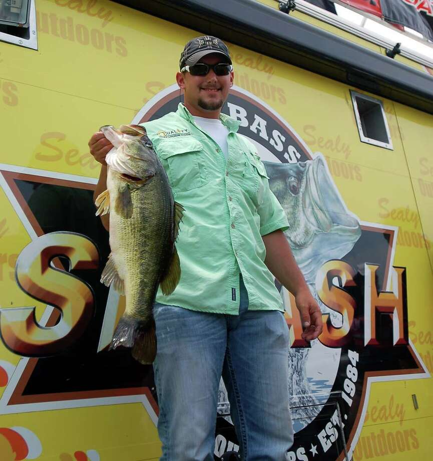 Wesley Thomas of Converse, LA brought in the biggest bass of the tournament so far weighing 9.62 lbs.  Will it hold for the next two days of competition?  photo by Patty Lenderman, Lakecaster