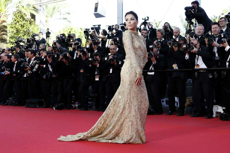 "Actress Eva Longoria poses on May 17, 2013 as she arrives for the screening of the film ""The Past"" presented in Competition at the 66th edition of the Cannes Film Festival in Cannes. Cannes, one of the world's top film festivals, opened on May 15 and will climax on May 26 with awards selected by a jury headed this year by Hollywood legend Steven Spielberg. Photo: VALERY HACHE, AFP/Getty Images / AFP"