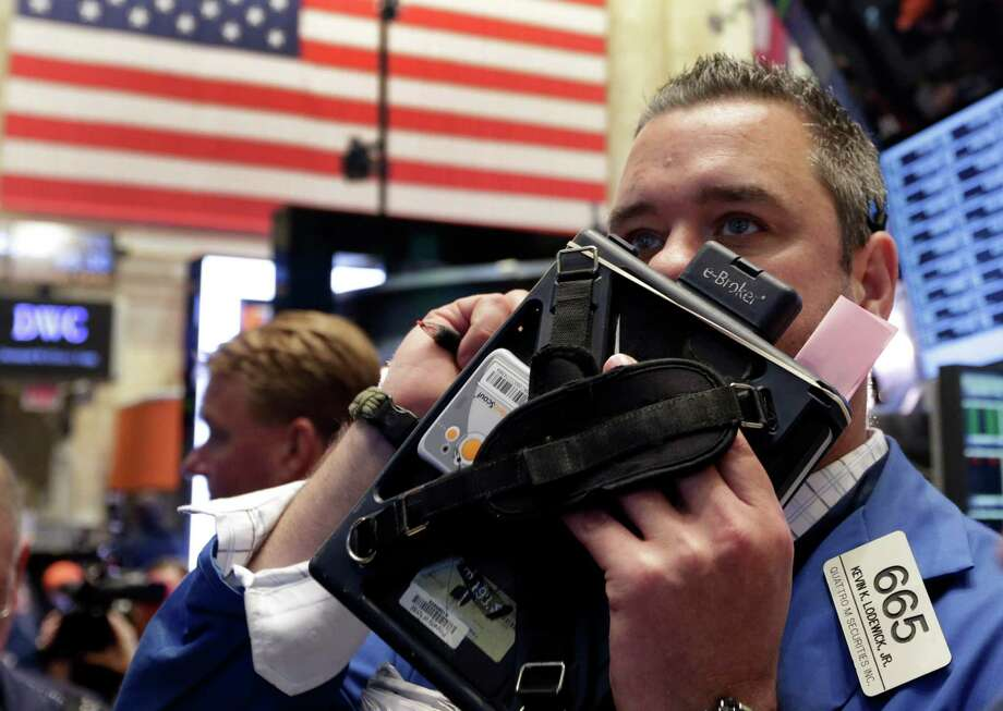 FILE - In this Thursday, May 2, 2013, file photo, Trader Kevin Lodewick works on the floor of the New York Stock Exchange. World stock markets were mixed Friday May 17, 2013 as investors digested a slew of disappointing data from the U.S. ahead of the release of a key measurement of the country's economic outlook.  (AP Photo/Richard Drew) Photo: Richard Drew