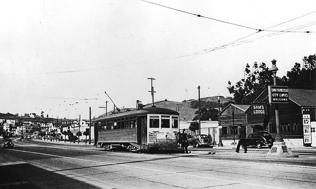 A streetcar makes it's final stop outside Sam's Lodge on Bayshore Boulevard right at the county line in the early 1940's. The log cabin was originally a tavern named George's Log Cabin and subsequently known as Roman's Cantina, Polynesian Hide-Away and the Moonrose Forest. It is currently owned by A. Silvestri Company.
