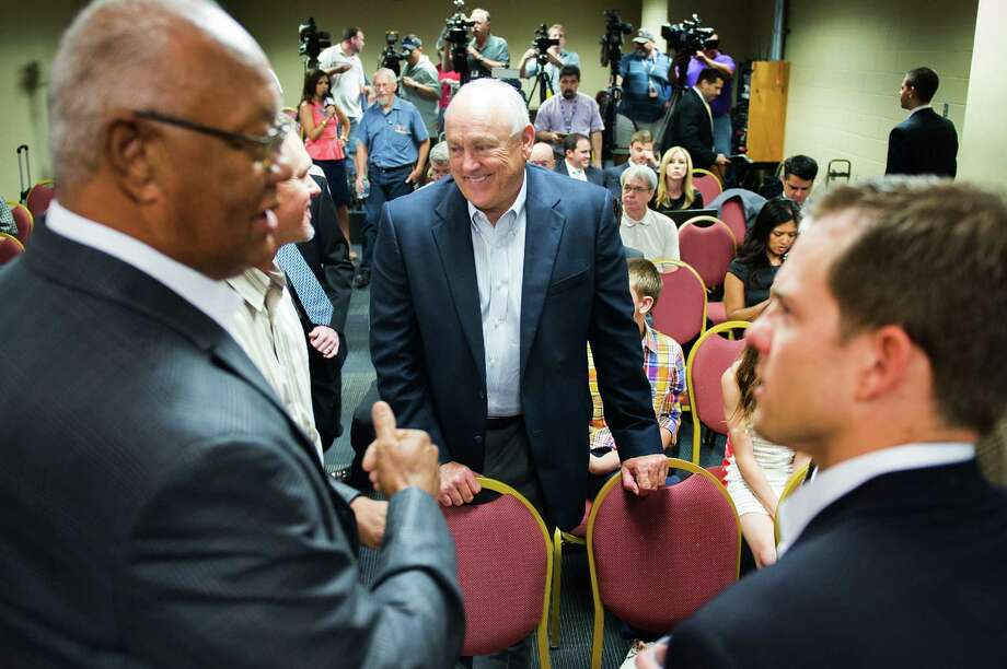 Houston Astros pitching great and current Texas Rangers executive Nolan Ryan, center, talks with, from left, former Astros' Enos Cabell and Craig Biggio, and his son Reese Ryan, right, before his eldest son Reid Ryan was announced as the new Astros president during a baseball news conference at Minute Maid Park on Friday, May 17, 2013, in Houston. (AP Photo/Houston Chronicle, Smiley N. Pool) MANDATORY CREDIT Photo: Smiley N. Pool, Associated Press / Houston Chronicle