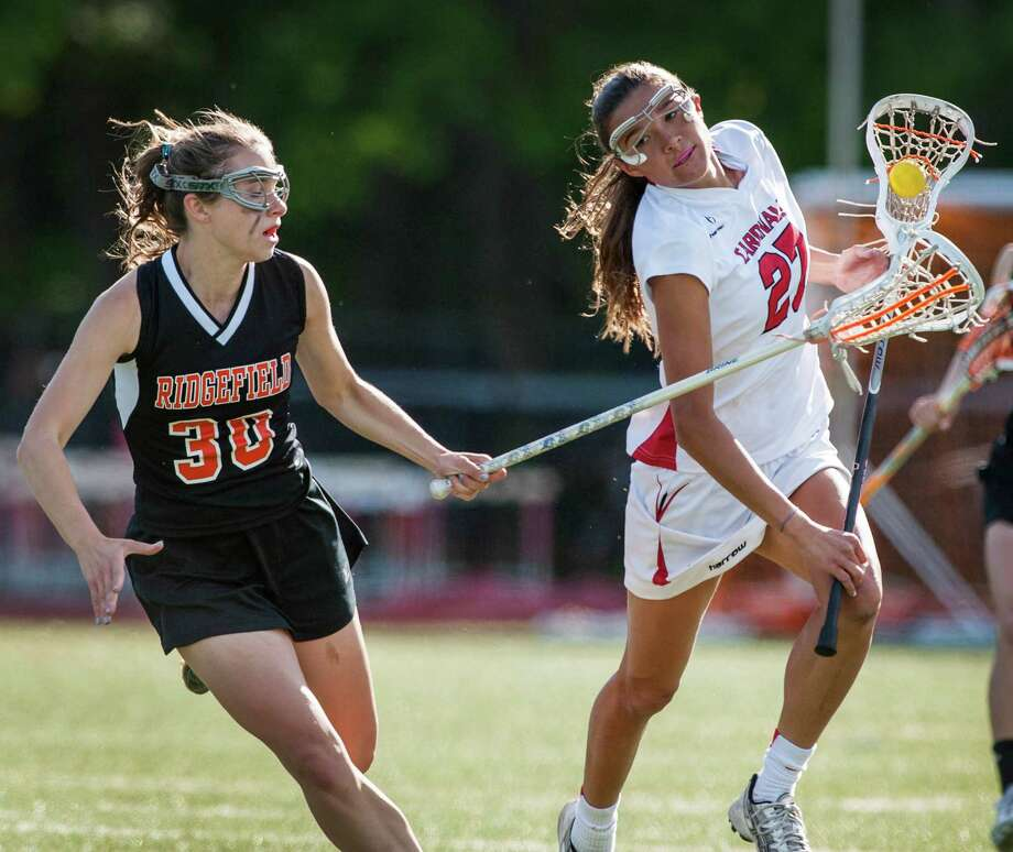 Greenwich high school's Carolyn Paletta tries to get by Ridgefield high school's Sandy Carpenter in an FCIAC quarterfinal girls lacrosse game played at Greenwich high school, Greenwich, CT on Friday, May 17th, 2013. Photo: Mark Conrad / Stamford Advocate Freelance